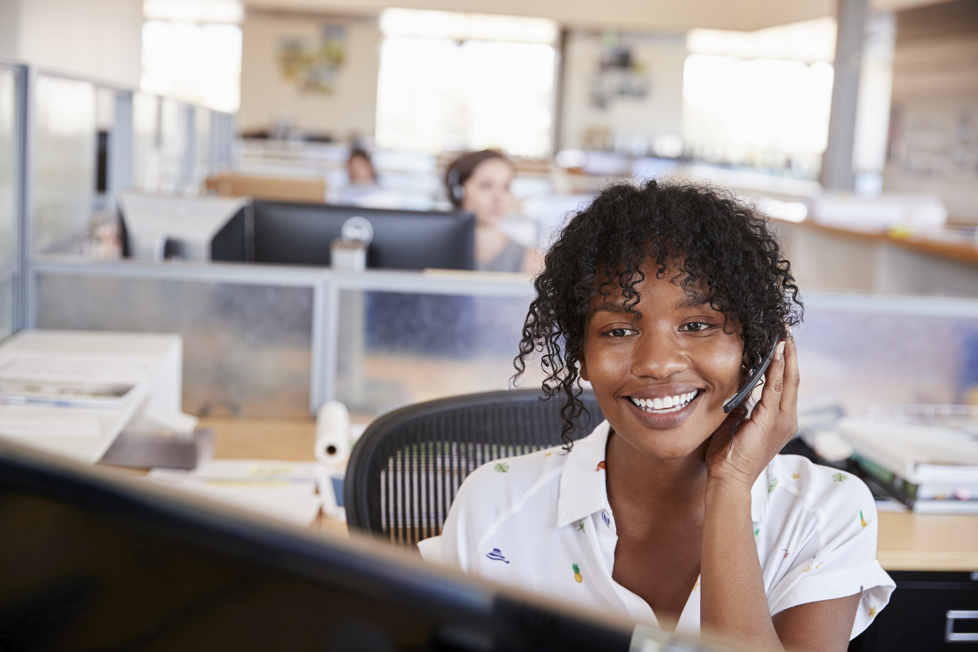 Young black woman working in a call centre